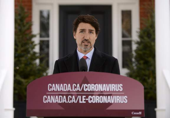Canada's Prime Minister Justin Trudeau addresses Canadians on the coronavirus situation from Rideau Cottage in Ottawa, Ontario, on Wednesday, March 25, 2020. (Sean Kilpatrick/The Canadian Press via AP)