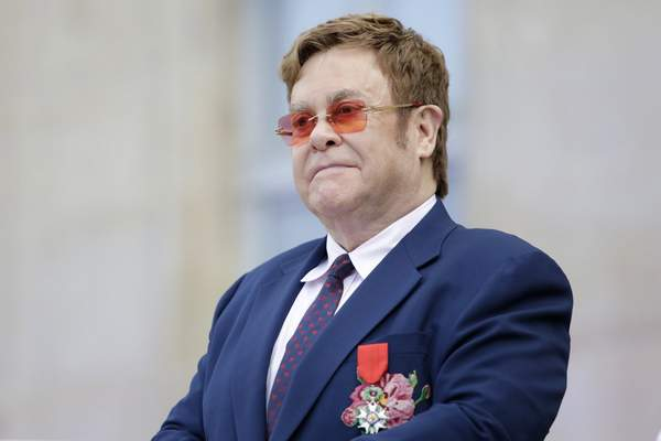 FILE - This June 21, 2019 file photo shows Elton John at a ceremony honoring him with the Legion of Honor in Paris. (AP Photo/Lewis Joly, Pool, File)