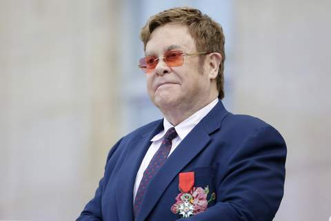 Virus Outbreak-Benefit Concert FILE - This June 21, 2019 file photo shows Elton John at a ceremony honoring him with the Legion of Honor in Paris. (AP Photo/Lewis Joly, Pool, File) (Lewis Joly STR)