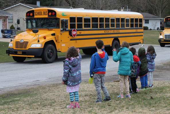 Teachers, staff and bus drivers from Coolspring Elementary School in Michigan City visited their students face-to-face â€