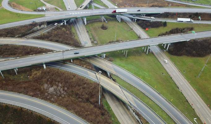 One of the busiest freeway interchanges in Ohio, Interstates 70, 71, and Ohio Rt. 315 appear almost empty Monday morning, March 23, 2020 as business and social lives shut down due to COVID-19. The state issued a stay-at-home order to take effect at 11:59 pm March 23. (Doral Chenoweth/The Columbus Dispatch via AP)