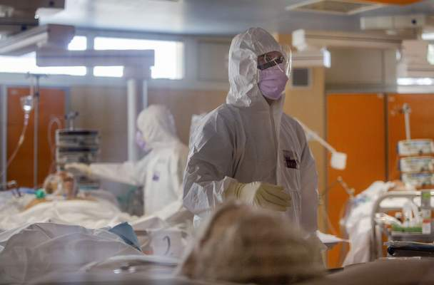 Medical staff of the Intensive Care Unit of the Casalpalocco COVID-19 Clinic in the outskirts of Rome tend to patients, Wednesday, March 25, 2020. (AP Photo/Domenico Stinellis)