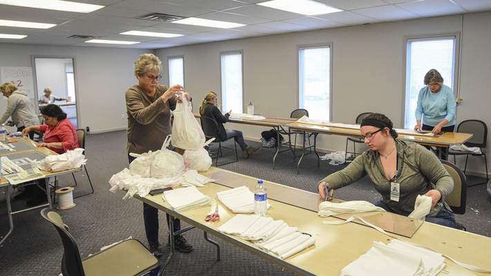 Mike Moore | The Journal Gazette Workers of Parkview Regional Medical Center work together to make medical mask kits on Wednesday 03.25.20