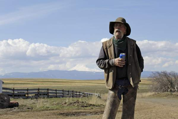 Associated Press Cattle rancher Mike Filbin stands on his property in Dufur, Ore., last week after herding some cows and talks about the impact the new coronavirus is having on his rural community.