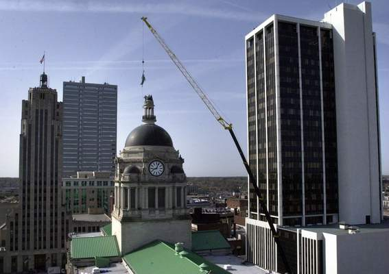 File  April 18, 2001: Workers guide the Liberty statue into place to the top of the Allen County Courthouse dome. It had been removed for restorations in 1995 and put on display inside the courthouse while work was being done on the building.