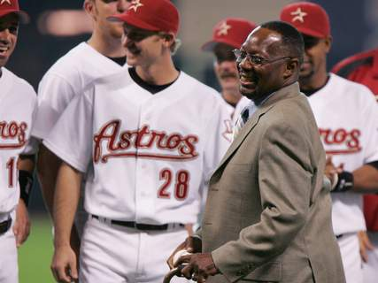 "Obit Jimmy Wynn Baseball FILE - In this June 25, 2005, file photo, former Houston Astro Jimmy Wynn is joined by current players as he prepares to throw out the ceremonial first pitch after his jersey number was retired in Houston. Wynn, the slugger who earned his nickname of ""The Toy Cannon"" during his days with the Astros in the 1960s and '70s, has died. Wynn was 78. The Astros said he died Thursday, March 26, 2020, in Houston, but did not provide further details. (AP Photo/Pat Sullivan, File) (Pat Sullivan