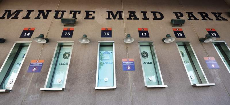 Box office windows remain closed at Minute Maid Park, March 25, 2020, in Houston. The Houston Astros would have hosted the Los Angeles Angels in their season-opening baseball game Thursday. (AP Photo/David J. Phillip)