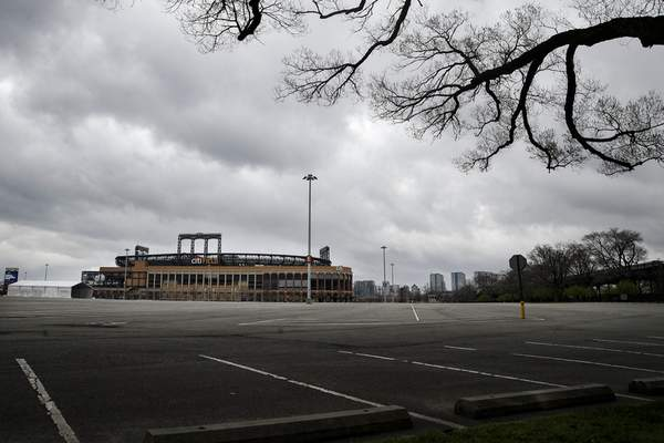 Parking lots sit empty surrounding Citifield, the home of the New York Mets, Wednesday, March 25, 2020, in the Queens borough of New York. (AP Photo/John Minchillo)