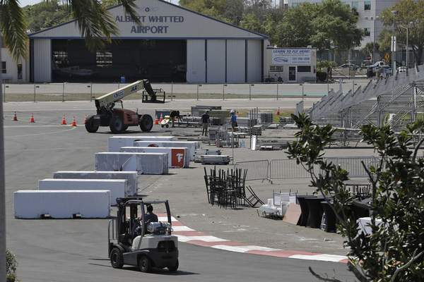 Worker begin to dismantle the fans grandstand for the IndyCar Firestone Grand Prix of St. Petersburg auto race, Monday, March 16, 2020, in St. Petersburg, Fla. Race organizers canceled the event to help curb the spread of the coronavirus. (AP Photo/Chris O'Meara)