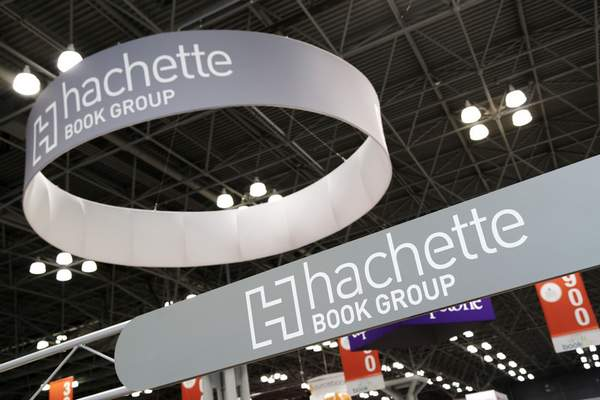 FILE - This May 28, 2015 file photo shows signs for Hachette Book Group displayed at BookExpo America in New York. (AP Photo/Mark Lennihan, File)