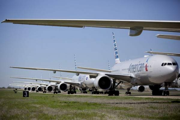 American Airlines 777's airplanes are parked at Tulsa International Airport Wednesday, March 25, 2020. (Mike Simons/Tulsa World via AP)