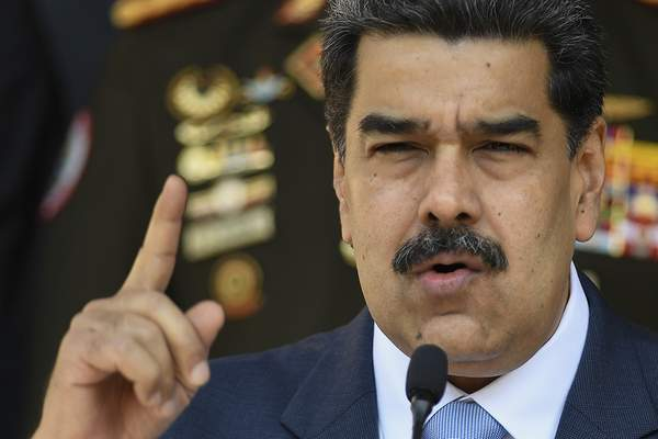 FILE - In this March 12, 2020, file photo, Venezuelan President Nicolas Maduro speaks at a press conference at the Miraflores Presidential Palace in Caracas, Venezuela. (AP Photo/Matias Delacroix, File)