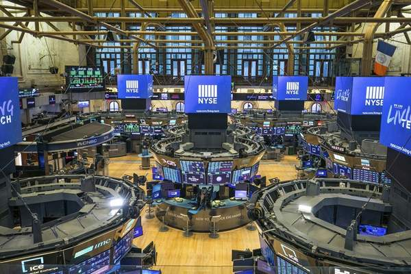 FILE - This photo provided by the New York Stock Exchange shows the unoccupied NYSE trading floor, closed temporarily for the first time in 228 years as a result of coronavirus concerns, Tuesday March 24, 2020. (Kearney Ferguson/NYSE via AP, File)