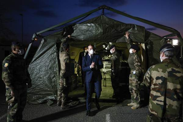 French President Emmanuel Macron wears a face mask during his visit at the military field hospital in Mulhouse, eastern France, Wednesday, March 25, 2020. (Mathieu Cugnot/Pool via AP)