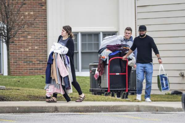 Mike Moore | The Journal Gazette  College students move out out their dorms at Purdue University Fort Wayne on Tuesday.