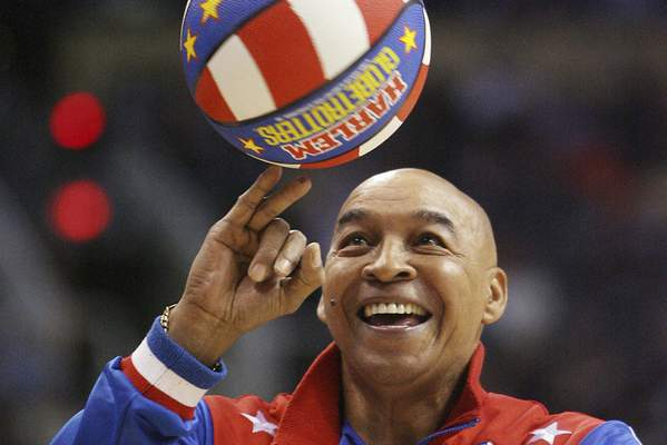 """Associated Press Harlem Globetrotters legend Fred """"Curly"""" Neal died Thursday."""