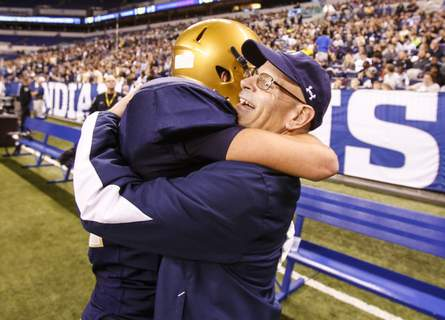 HS State Football File Chris Svarczkopf hugs Nick Fiacable at the Class 4A state title game in 2015, which the Saints won 27-3. (Chad RyanStaff Photographer)