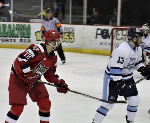 Sabrina Mason | Special to The Journal Gazette  Former Indiana Tech player Alex Gregorich, left, skates for the Port Huron Prowlers.