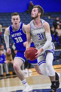 MIke Moore | The Journal Gazette Saint Francis senior Austin Compton and his teammates had won their first-round matchup barely two hours before the cancellation of their season due to the virus.  (The_Journal_Gazette)