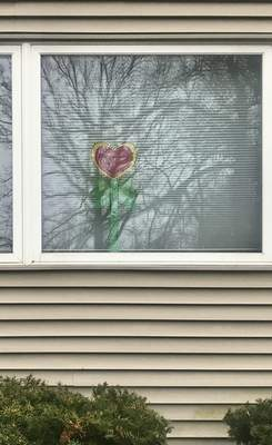 Jamie Duffy | The Journal Gazette  A heart was paired with a flower at the home of Amy Smith Szwabowicz on Hawthorne Street in Wildwood Park.