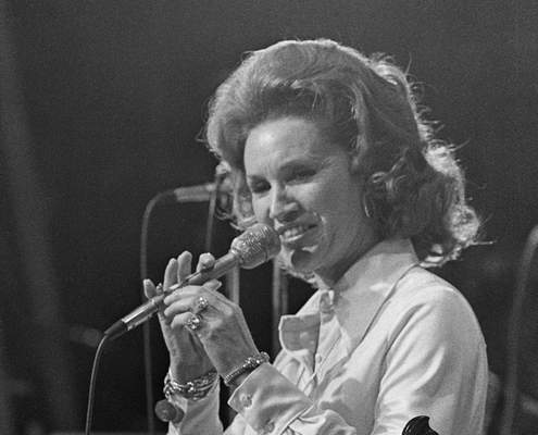 FILE - In a March 18, 1974 file photo, Country music star Jan Howard performs during the Grand Ole Opry's last show at Ryman Auditorium in Nashville, Tenn. Howard, died Saturday, March 29, 2020 at age 91, according to an announcement by the Grand Ole Opry. She was 91. (AP Photo/John Duricka, File)