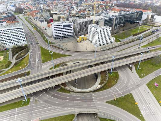 Only occasionally do cars drive over the city's largest traffic junction, the Riebeckplatz in Halle, Germany, March 29, 2020. There are exit restrictions throughout Germany due to the coronavirus. (Jan Woitas/dpa via AP)