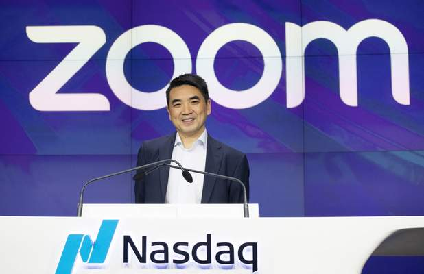 FILE - In this April 18, 2019 file photo, Zoom CEO Eric Yuan attends the opening bell at Nasdaq as his company holds its IPO in New York. (AP Photo/Mark Lennihan, File)