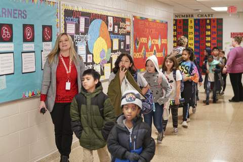 Mike Moore | The Journal Gazette Bloomingdale Elementary School Principal Jennifer Evans walks with students last month. Evans is in her sixth year at Bloomingdale and makes it her duty to be involved in the community.
