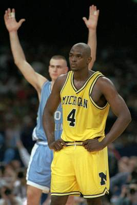 Associated Press North Carolina's Eric Montross celebrates behind Michigan's Chris Webber late in the 1993 NCAA title game after Webber had called a timeout, even though Michigan was out of them.