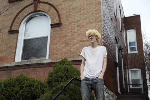 Virus Outbreak Rent Strike In this Saturday, March 28, 2020 photo, Kyle Kofron poses for a photo outside his home in St. Louis. (AP Photo/Jeff Roberson) (Jeff Roberson STF)
