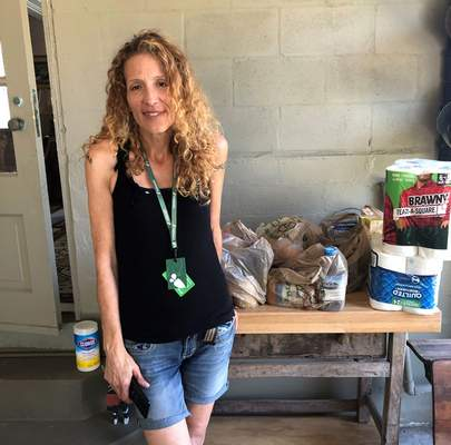 Instacart gig worker Summer Cooper, 39, delivers groceries, Saturday, March 28, 2020, in Belleair Beach, Fla. Cooper, 39, started working as an Instacart shopper in the Tampa Bay area in Florida recently after losing her position as a server at a hotel restaurant. (AP Photo/Curt Anderson)