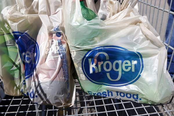 FILE - In this June 15, 2017, file photo, bagged purchases from the Kroger grocery store in Flowood, Miss., sit inside this shopping cart. (AP Photo/Rogelio V. Solis, File)