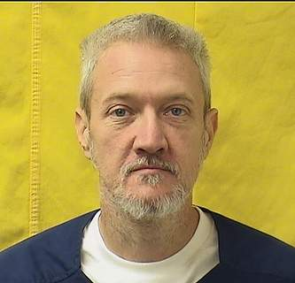 Virus Outbreak Ohio Prisons This undated photo provided by Ohio Department of Rehabilitation and Correction shows Derek Lichtenwalter. Lichtenwalter, who is serving a two-year sentence on a