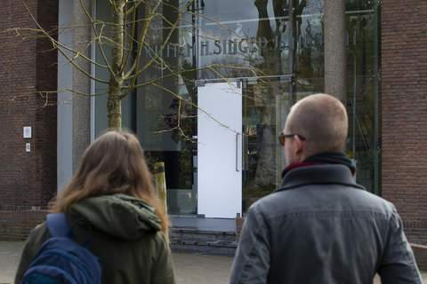 Virus Outbreak Netherlands Museum Break-in Two people look at the glass door which was smashed during a break-in at the Singer Museum in Laren, Netherlands, Monday March 30, 2020. (AP Photo/Peter Dejong) (Peter Dejong