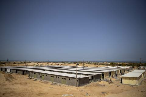 Virus Outbreak Gaza Quarantine Palestinian workers construct a quarantine complex to be used for coronavirus cases, in the southern Gaza Strip, Monday, March 30, 2020. (AP Photo/Khalil Hamra) (Khalil Hamra STF)