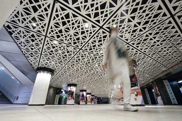 FILE - In this March 28, 2020, file, photo, a man walks at empty Ginza station underpass in Tokyo Saturday, March 28, 2020. (AP Photo/Eugene Hoshiko, File)