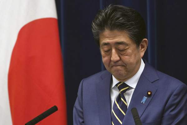 FILE - In this March 28, 2020, file, photo, Japanese Prime Minister Shinzo Abe bites his lips during his speech about the coronavirus situation in Japan at the prime minister's official residence in Tokyo. (AP Photo/Eugene Hoshiko, File)