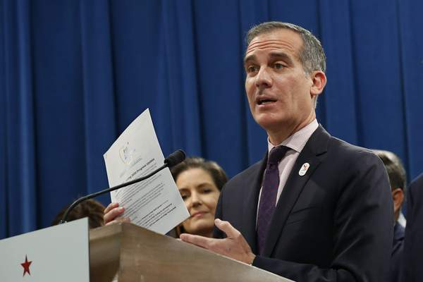 FILE - In this Monday, March 9, 2020, file photo, Los Angeles Mayor Eric Garcetti speaks at a news conference at the Capitol in Sacramento, Calif. In Los Angeles. (AP Photo/Rich Pedroncelli, File)
