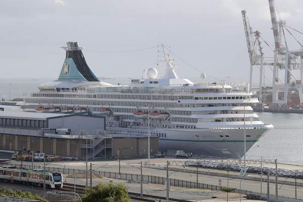 This Friday, March 27, 2020, photo shows the cruise ship Artania docked at Fremantle harbour in Fremantle, Australia. (Richard Wainwright/AAP Image via AP)