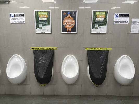 Toilets are covered up to prevent use and encourage social distancing to help prevent the spread of the coronavirus at Clacket Lane services on the M25 orbital motorway around London, Monday, March 30, 2020. (AP Photo/Matt Dunham)