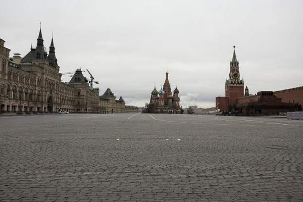 A view of an empty Red square, with the St. Basil's Cathedral, center, and Kremlin's Spasskaya Tower, right, in Moscow, Russia, Monday, March 30, 2020. (AP Photo/Pavel Golovkin)