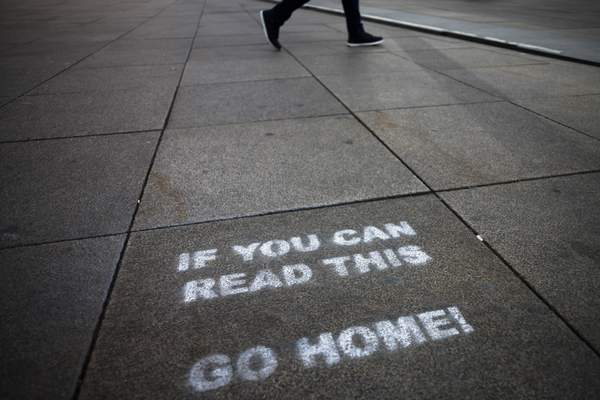 A a message demanding the people to go home is sprayed on the ground of Alexanderplatz square in Berlin, Germany, Monday, March 30, 2020. (AP Photo/Markus Schreiber)