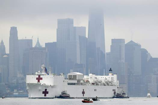 Virus Outbreak New York Associated Press  The Navy hospital ship USNS Comfort passes lower Manhattan on its way to docking in New York, Monday, March 30, 2020. The ship has 1,000 beds and 12 operating rooms that could be up and running within 24 hours of its arrival on Monday morning. It's expected to bolster a besieged health care system by treating non-coronavirus patients while hospitals treat people with COVID-19. AP Photo/Seth Wenig) (Seth WenigSTF)