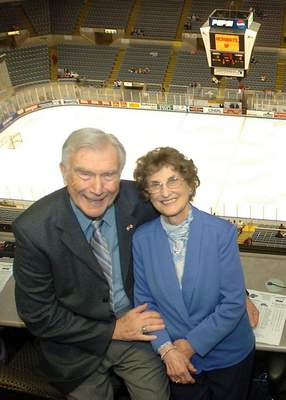 Samuel Hoffman | The Journal Gazette: WOWO broadcaster Bob Chase and his wife, Murph, at Memorial Coliseum in 2005. Muriel Wallenstein died Tuesday at age 96.