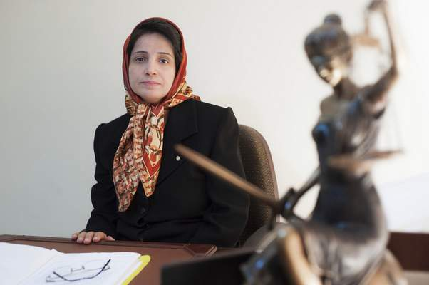 FILE - In this Nov. 1, 2008 file photo, Iranian human rights lawyer Nasrin Sotoudeh, poses for a photograph in her office in Tehran, Iran. (AP Photo/Arash Ashourinia, File)