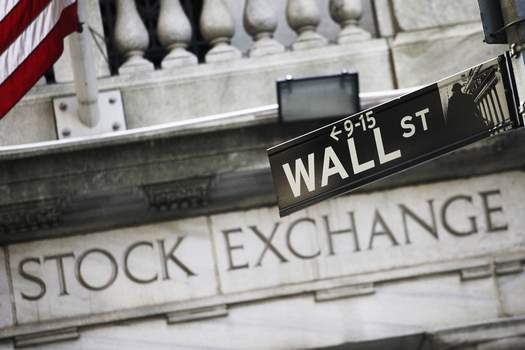 Wall Street FILE - This July 16, 2013 file photo shows a street sign for Wall Street outside the New York Stock Exchange in New York. (AP Photo/Mark Lennihan, File) (Mark Lennihan STF)