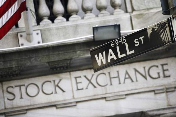 FILE - This July 16, 2013 file photo shows a street sign for Wall Street outside the New York Stock Exchange in New York. (AP Photo/Mark Lennihan, File)