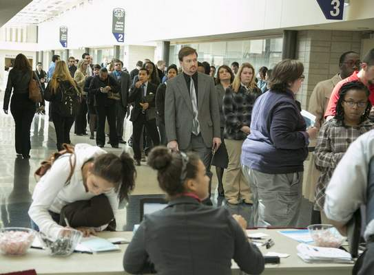 FILEA line of job seekers wait to register for the Northeast Indiana Career Enrichment Job Fair at IPFW's Gates Sports Center.