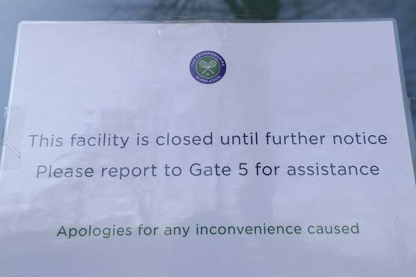 A signs outside one of the main gates to Wimbledon as it is announced the the Wimbledon tennis Championships for 2020 has been cancelled due to the coronavirus in London, Wednesday, April 1, 2020. (AP Photo/Kirsty Wigglesworth)