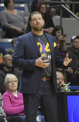 Katie Fyfe | The Journal Gazette  Mad Ants coach Steve Gansey wears a No. 24 shirt to honor the late Kobe Bryant at Memorial Coliseum on Jan. 31.
